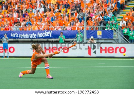 THE HAGUE, NETHERLANDS - JUNE14: Captain Maartje Paumen of the Dutch womens field hockey team scores 1-0 against Australia during the finals of the Rabobank Hockey World Cup. in 2014 - stock photo