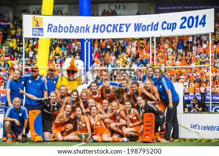 THE HAGUE, NETHERLANDS - JUNE 14: Team photo of the victorious Dutch Team, coaches and support staff at the prize giving ceremony of the world championships hockey 2014 - stock photo