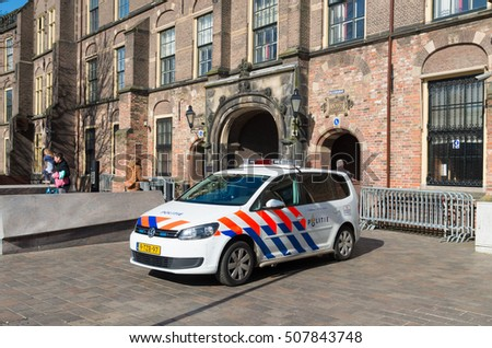 THE HAGUE, NETHERLANDS - MARCH 28, 2016: Police car in front of the Binnenhof, the settlement of the dutch parliament