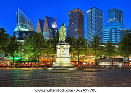 THE HAGUE, NETHERLANDS - MAY 23, 2015: Het Plein Square with the statue of William the Silent on the background of the city's skyscrapers in the evening. The square is known for its many restaurants. - stock photo