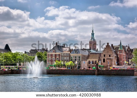 The Hague, Netherlands - May 12th 2014 - Nice buildings with a lake in the foreground and blue sky in the background, The Hague, Netherlands, Europe.