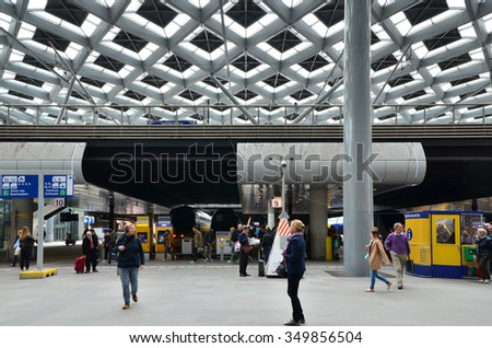 The Hague, Netherlands - May 8, 2015: Travelers at central Station of The Hague, Netherlands on May 8, 2015. The station is the largest railway station in The Hague. - stock photo