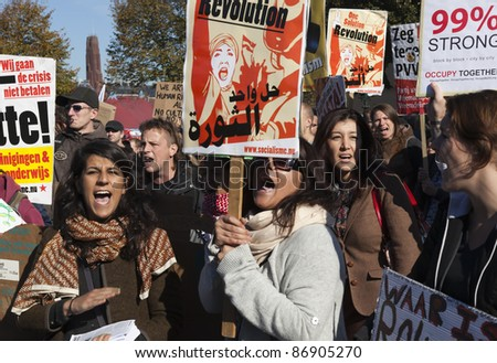 THE HAGUE - OCTOBER 15:  An unidentified women holding banners of Socialist party shouting during the Occupy protest on October 15, 2011 in The Hague, The Netherlands.