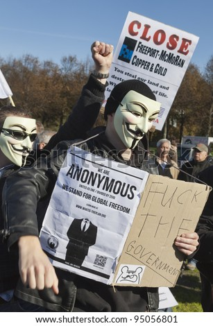 THE HAGUE – OCTOBER 15: Three masked members of Anonymous protesting during the Occupy protest on October 15, 2011 in The Hague, The Netherlands.