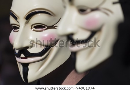 THE HAGUE – OCTOBER 15: Two masked members of Anonymous protesting during the Occupy protest on October 15, 2011 in The Hague, The Netherlands. - stock photo