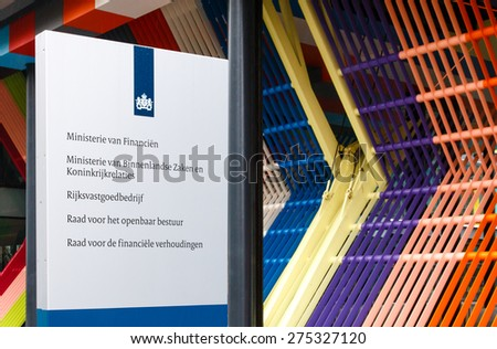 THE HAGUE, THE NETHERLANDS - APRIL 25 2015: Sign at the entrance to the Dutch Ministry of Finance, Ministry of Interior and Kingdom Relations and other departments of the central government - stock photo