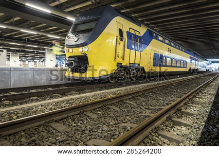 THE HAGUE, THE NETHERLANDS - MAY 20: Train at the central station of The Hague on May 20, 2015 in the city of The Hague, the Netherlands - stock photo