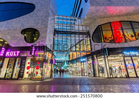 "THE HAGUE, THE NETHERLANDS - 8th of February, 2015: Night shot of the new shopping area ""De Passage"", on Grote Marktstraat shopping street, close to the Spui. - stock photo"
