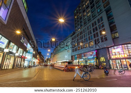 THE HAGUE, THE NETHERLANDS - 8th of February 8th, 2015: Night shot of Grote Marktstraat shopping street, close to the Spui.  - stock photo
