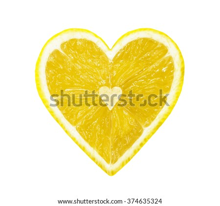 The half of the lemon in the form of heart isolated on a white - stock photo