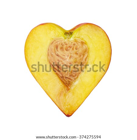 The half of the peach in the form of heart isolated on a white - stock photo