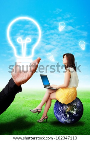 The hand give light bulb to lady on globe for help : Elements of this image furnished by NASA - stock photo