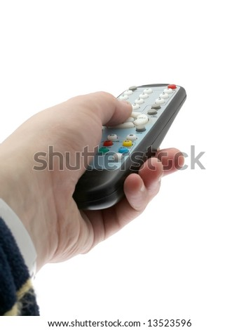 The hand holds a remote control the TV - stock photo
