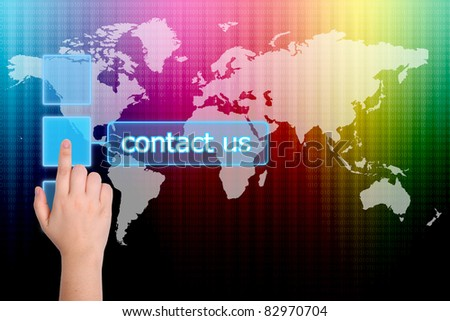 The hand is pressing the contact us button  on a touch screen interface - stock photo