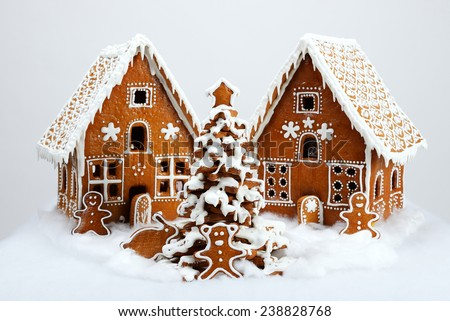 The hand-made eatable gingerbread houses and New Year Tree with snow decoration - stock photo