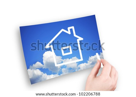 The hand of the man draws the house in the sky - stock photo