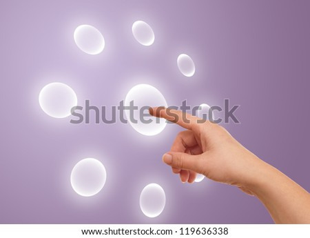 the hand on the flow of several button, futuristic digital technology - stock photo