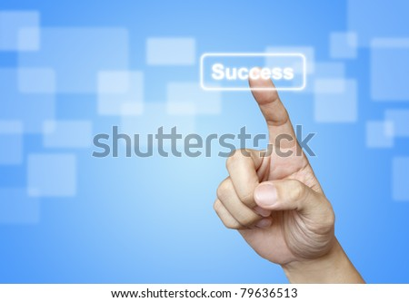 The hand press Success button on blue background