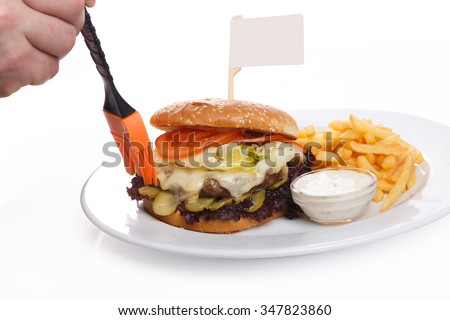The hand smears butter burger with a flag on a white background - stock photo