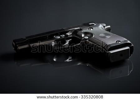 the handgun on black background - stock photo