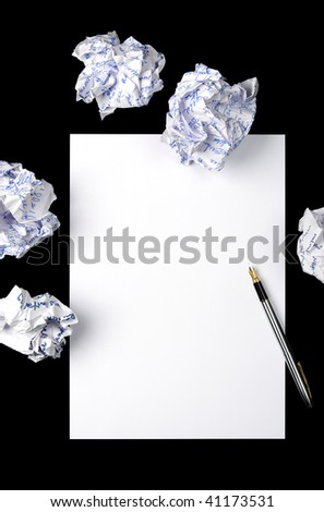 The handle lying on a blank leaf of a paper and crushed sheet on a black background - stock photo