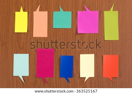 The Handmade Colorful Origami Balloons on the Wooden Background