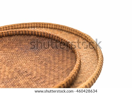 The handmade  wooden basket is good quality put on a white background.
