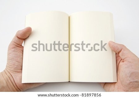 The hands holding a blank book - stock photo