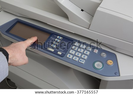 The hands of a young businessman is placing a document