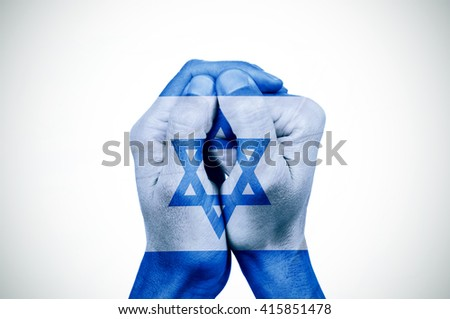 the hands of a young man put together patterned with the flag of Israel, with a slight vignette added - stock photo