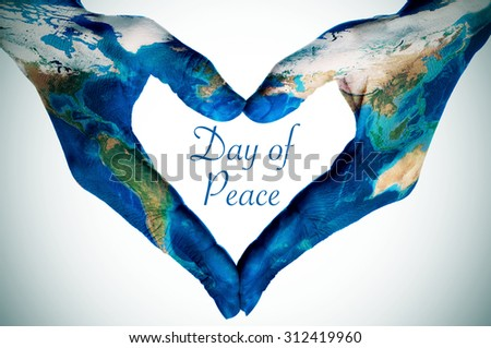 the hands of a young woman forming a heart patterned with a world map (furnished by NASA) and the text day of peace, slight vignette added - stock photo