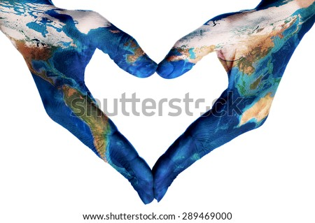 the hands of a young woman forming a heart patterned with a world map (furnished by NASA), on a white background - stock photo