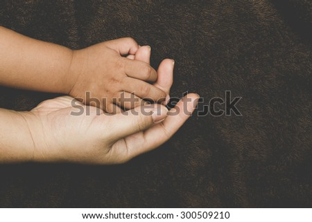The hands of children and parents. - stock photo