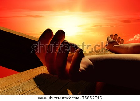 The hands of Jesus Christ on the skyline. - stock photo