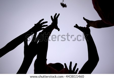 The hands of people who are pursuing, Game of scrimmage Some objects thrown into the air - stock photo