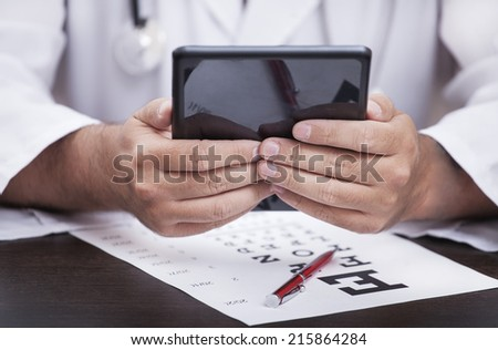 the hands of the doctor holding a tablet - stock photo