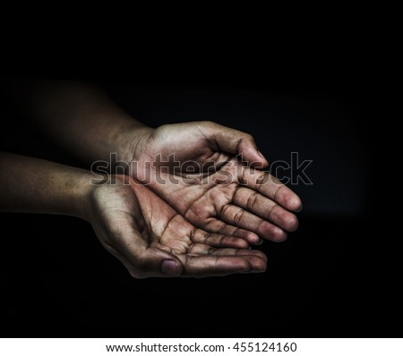 The hands of the hungry. help concept, peace concept, health concept. - stock photo