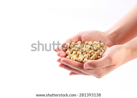 the hands of woman with soybeans