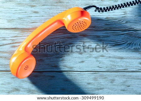 The handset on the table - stock photo