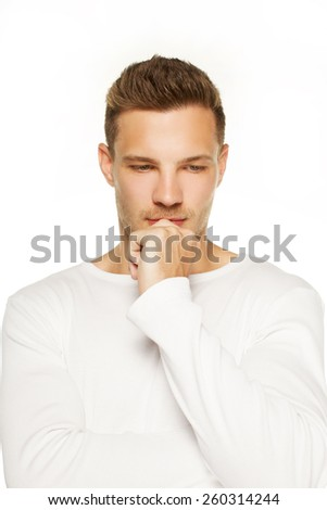 The handsome man is thinking on on white background - stock photo