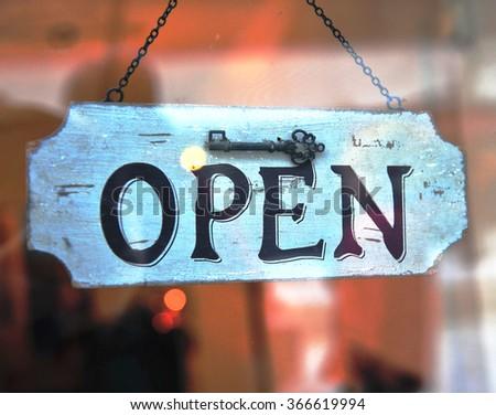 The hanging Open sign in the door  - stock photo
