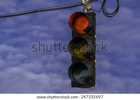 The hanging street light signal.
