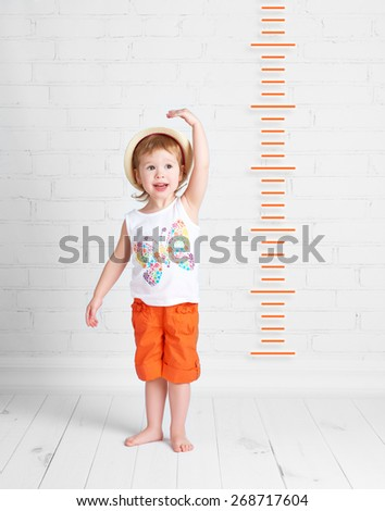 the happy beautiful baby girl growth measures - stock photo