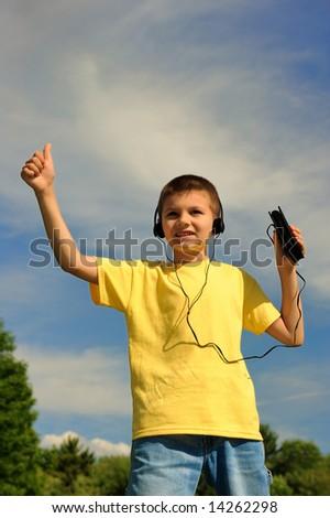 The happy boy in headphones - stock photo