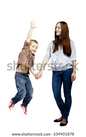 The happy boy is jumping with older sister. - stock photo