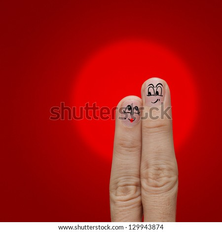 the happy couple in love with painted smiley and fall in love - stock photo