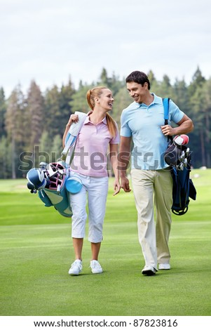 The happy couple on the golf course - stock photo