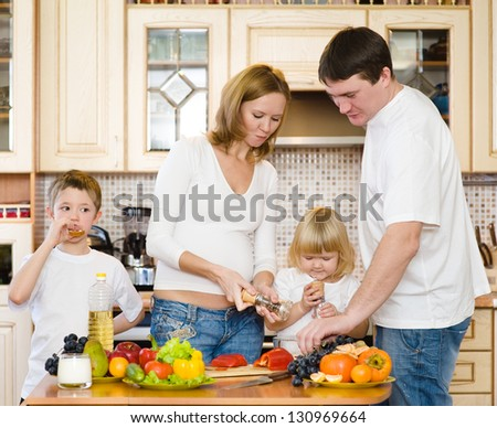 the happy family makes a dinner in kitchen - stock photo
