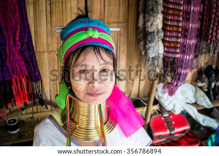 The happy long neck Karen woman. This picture of Karen woman (hill tribe) who lives in Chiang Rai province , Thailand in the after noon of 30th December 2015 in Tha Khao Pleuk village by editorial