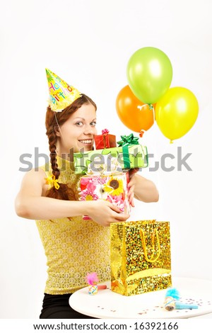 The happy young girl holds in hands set of boxes with gifts on a white background